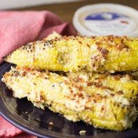 Southern street corn is loaded up with all kinds of good stuff - The Chef and His Wife pimento cheese, mayo, and bacon - for a delicious side dish! #ad #thechefandhiswife   Recipe from Chattavore.com