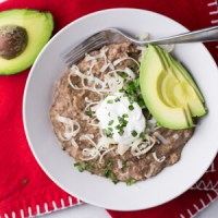 Instant Pot refried beans are super-simple, delicious, and quick enough to make from start to finish for a weeknight dinner!   Recipe from Chattavore.com