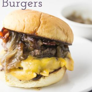 In my opinion, these smashed burgers are the PERFECT burgers! BBQ sauce, bacon, and caramelized onions make them even better! | Recipe from Chattavore.com