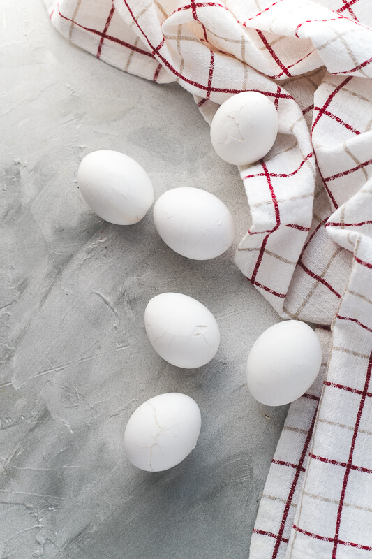 a photograph of hardboiled eggs on a gray background
