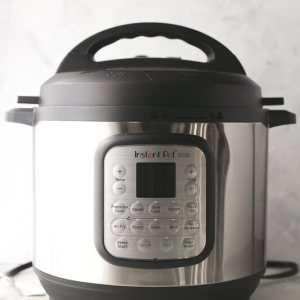 a photograph of an Instant Pot Duo Crisp with the pressure cooker lid
