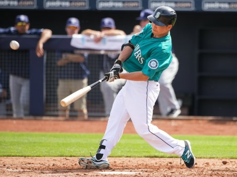 Outfielder Nori Aoki flies out to right in the bottom of the third as the Seattle Mariners play their annual Charity Game against the San Diego Padres for the first game of spring training in Peoria, Arizona, Wednesday March 2, 2016. (Bettina Hansen / The Seattle Times)