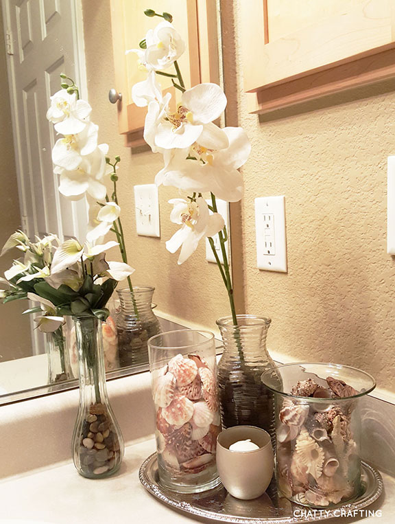 Affordable dollar store coastal bathroom idea chatty for Affordable bathroom accessories