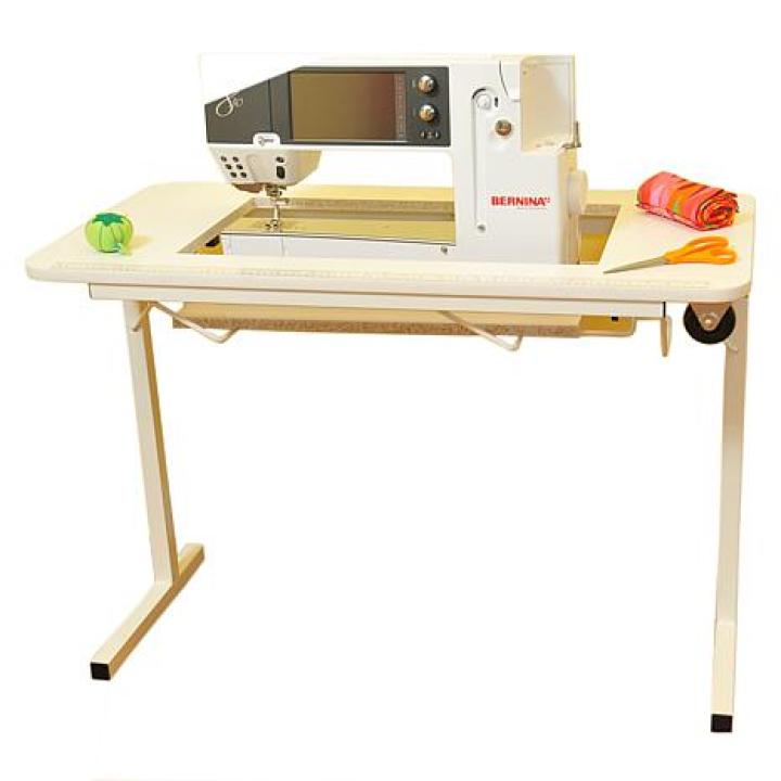 Can we talk about how awesome this sewing table is for a minute?! If you have a small space to work this would be a great addition. When you're done, just fold it up, and put the table in your closet. Side note, this was the best photo I could find of it. There's a ton of awesome 5 star reviews for this also!