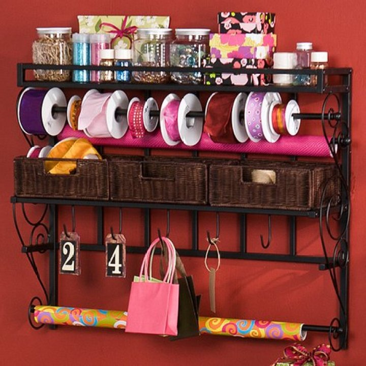 Ok, when I found this I was seriously so excited! I personally have one wall in mind that this would look absolutely amazing on. It's PERFECT if you have a smaller space to work with. Ribbons, jars, fabric, sizzors, needlework accessories, yarn, paper craft items... really you can store just about any accessory on this nifty wall mount!