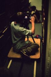 Chauncey directs and shoots a scene in a library. pc Charlie Theobald