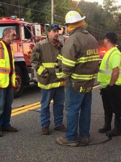 Firefighters volunterring at the Children's Safety Village