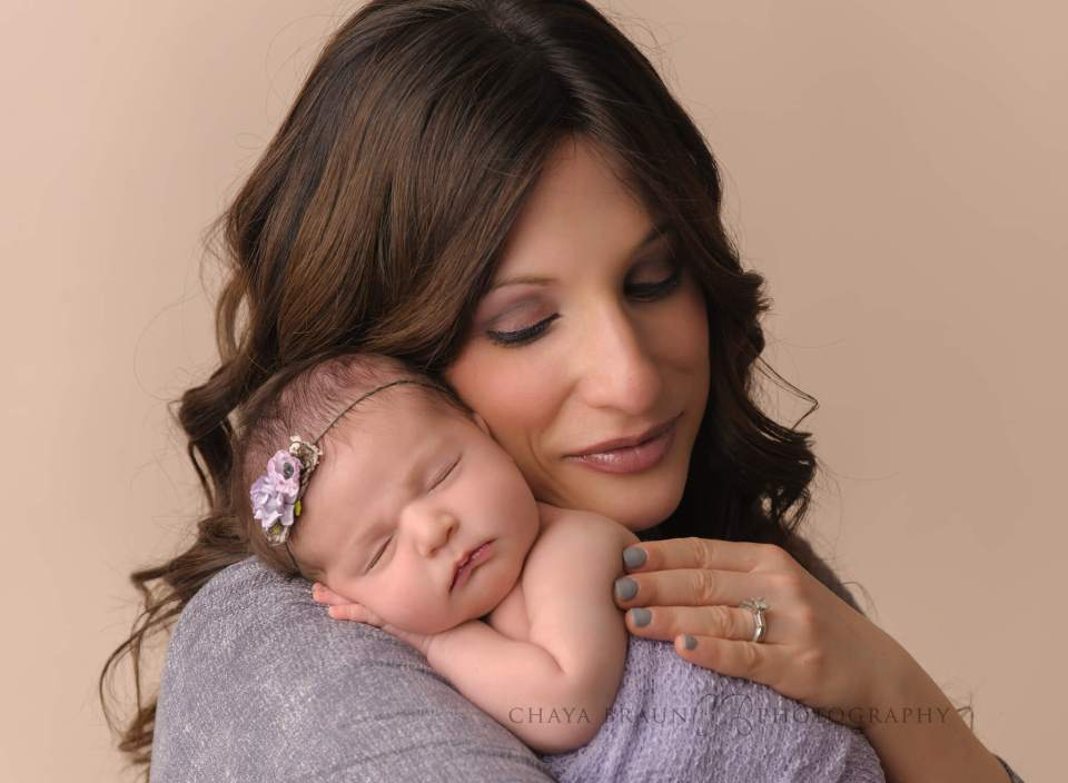 mom and newborn baby professional photo