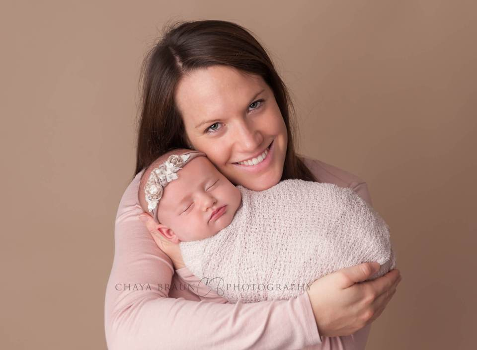 mother and newborn baby pose