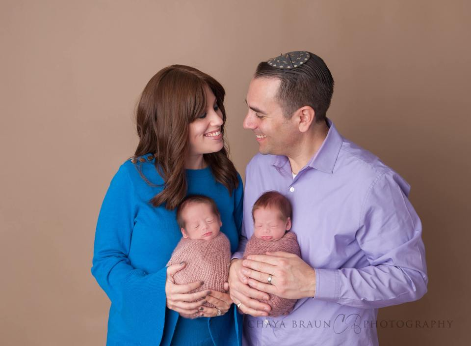 parents and twin newborn babies