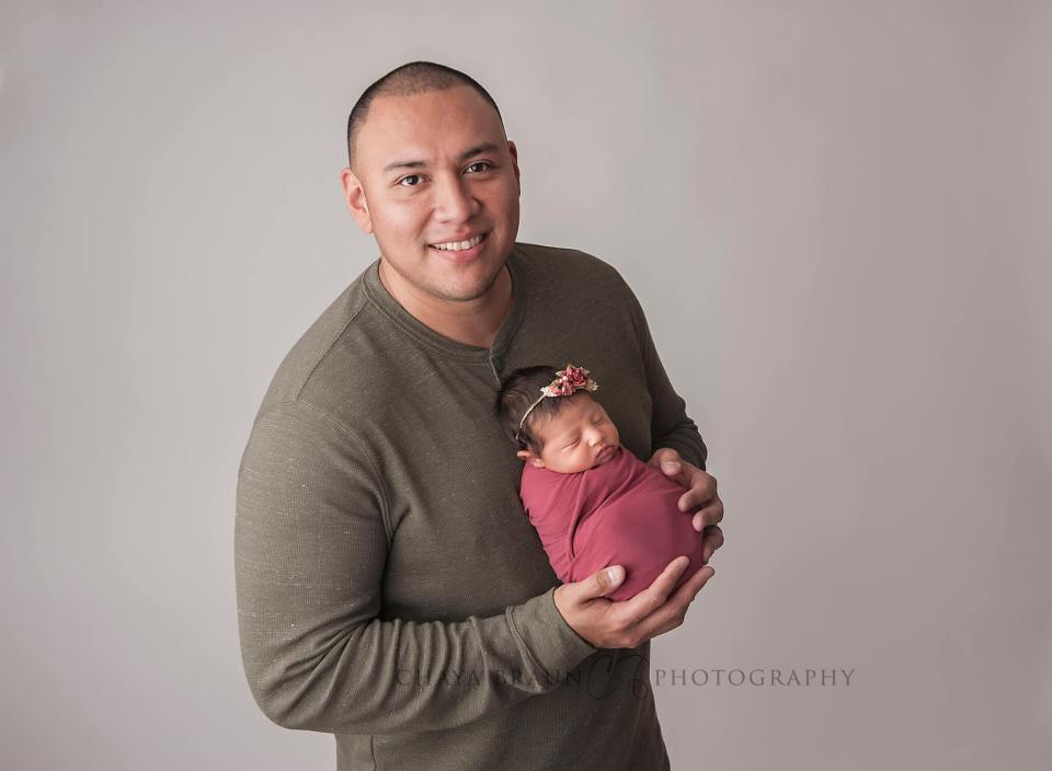 Dad and newborn baby photo in Maryland