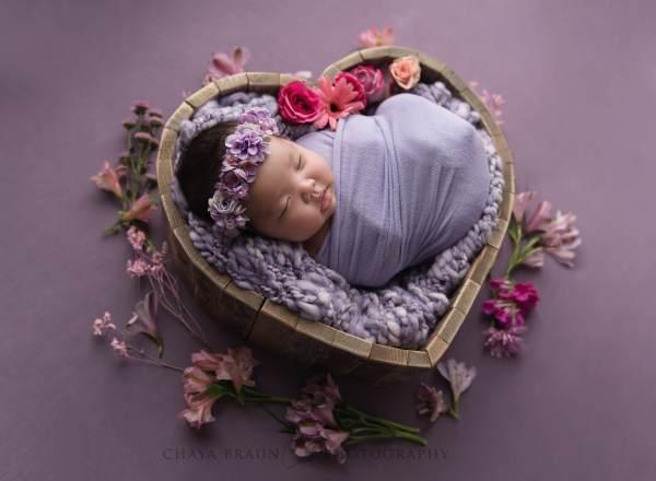 newborn baby in heart bowl