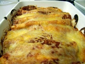 what to do with leftover turkey: Turkey enchiladas with red sauce