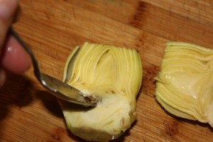 use a grapefruit spoon to dig the choke out of the artichoke