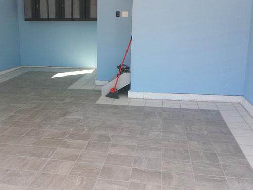 Nuevo piso de porcelanato en el garaje