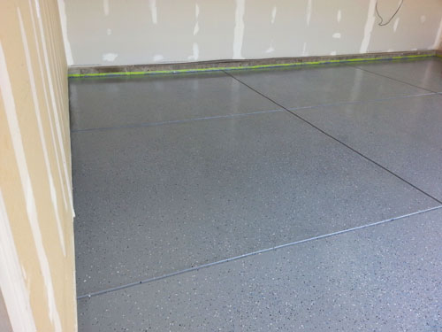 Epoxy coated garage floor as part as my garage finishing project