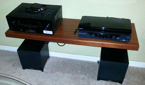 DIY floating shelf for the dvd player, receiver, subs in place