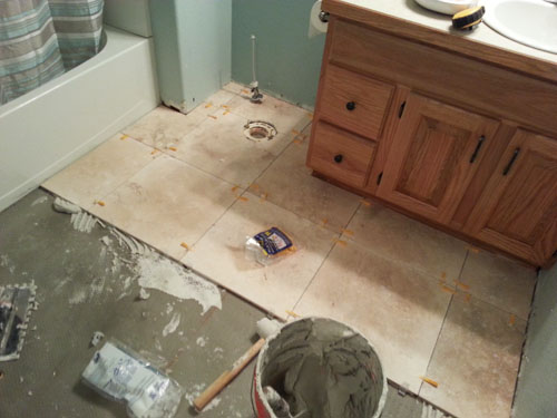 Laying Travertine Tile in the Bathroom Floors