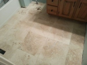 Installing travertine tile in the bathroom floors