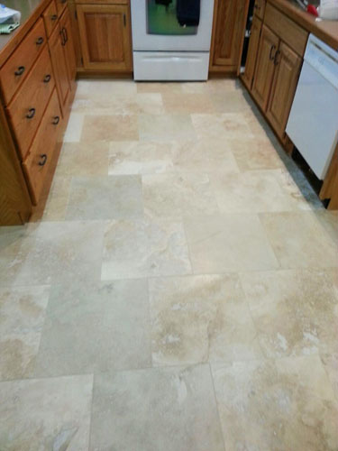 New brick pattern travertine kitchen flooring completely finished