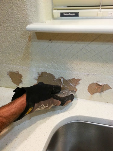 Scratching wall for tile backsplash installation