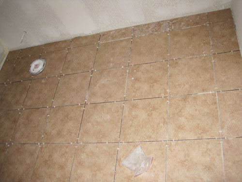 How to lay tile in basement bathroom