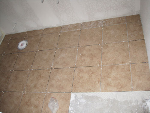Laying tile in basement bathroom