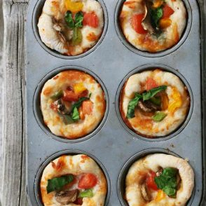 Mini pizzas made in a muffin tin: Use your leftover pizza dough and make these super cheap appetizers!
