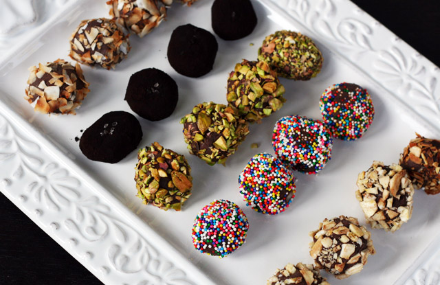 Chocolate ganache truffles, rolled in toasted coconut, black cocoa and sea salt, pistachios, candy sprinkles, and toasted almonds.