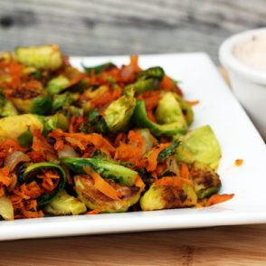 Sweet potato and brussels sprouts hash with chipotle crema recipe: A flavor match made in heaven! click through for recipe.