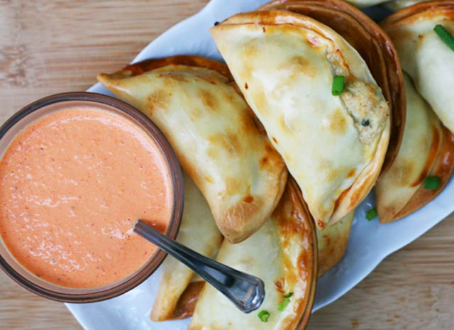 Turkey empanadas, made out of leftover turkey. Served with a red pepper sauce. Repin to save!
