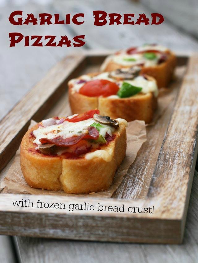 Homemade pizzas with a garlic bread crust. Click through for recipe!