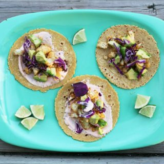 Old Bay Cauliflower Tacos - With avocado and a spicy sauce. Repin to save!