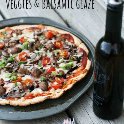 Pizza with HOMEMADE SAUSAGE, veggies, and a balsamic glaze. SO delicious! Click through for instructions.