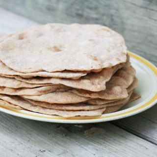 Homemade tortilla shells/burrito shells. Whole wheat and made with coconut oil. Click through for recipe!