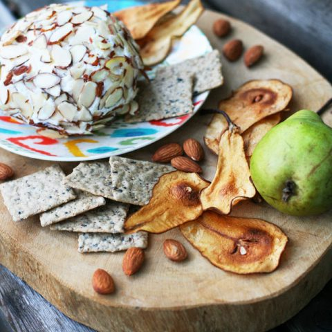 Make a tropical cheese ball (with pineapple, vanilla, and nuts) and serve with homemade pear chips. Click through for recipe.