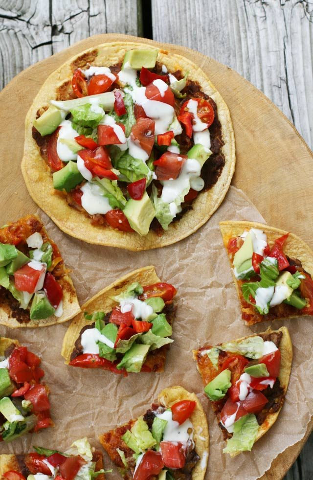 Mexican-style corn tortilla pizzas. Feed a crowd for not a lot of money!