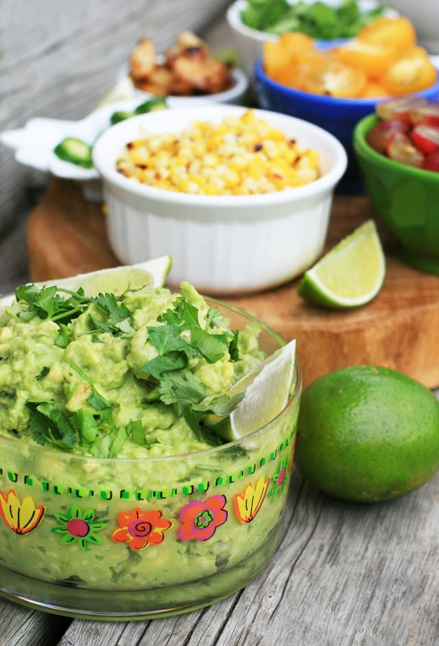 Assemble a DIY guacamole bar: A basic guacamole recipe plus lots and lots of topping options. Click through for details!