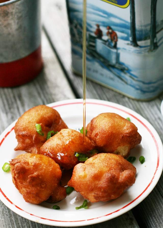 Corn fritters, drizzled in maple syrup. A totally indulgent recipe, inspired by fritters at the Minnesota State Fair.