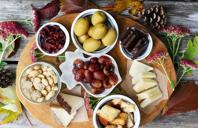 A delicious appetizer platter with budget-friendly ingredients, including roasted grapes. Click through for recipe!