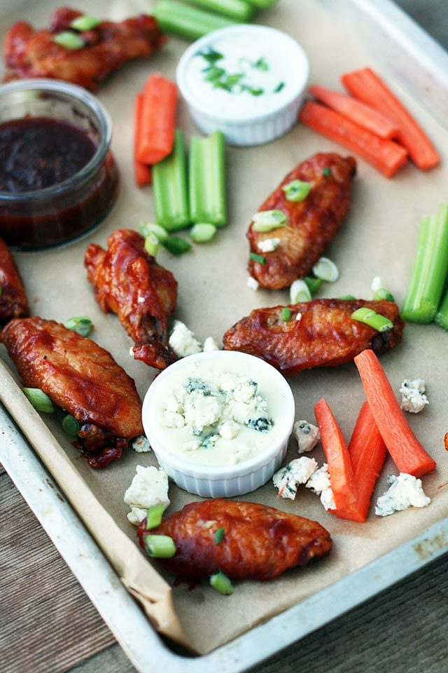 Bourbon-sriracha wings: Made crispy in the OVEN! Click through for recipe.