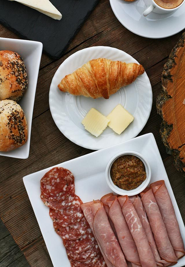A European-style breakfast, complete with meats, cheeses, and croissants. Click through for more ideas!