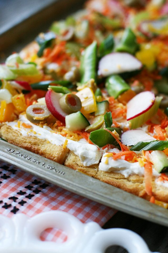 Cold veggie pizza: Crescent roll crust, herb cream cheese, and plenty of fresh veggies!