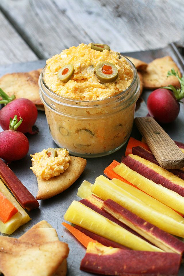 Pimento and green olive cheese spread. Delicious with pita chips and veggies. Click through for recipe!