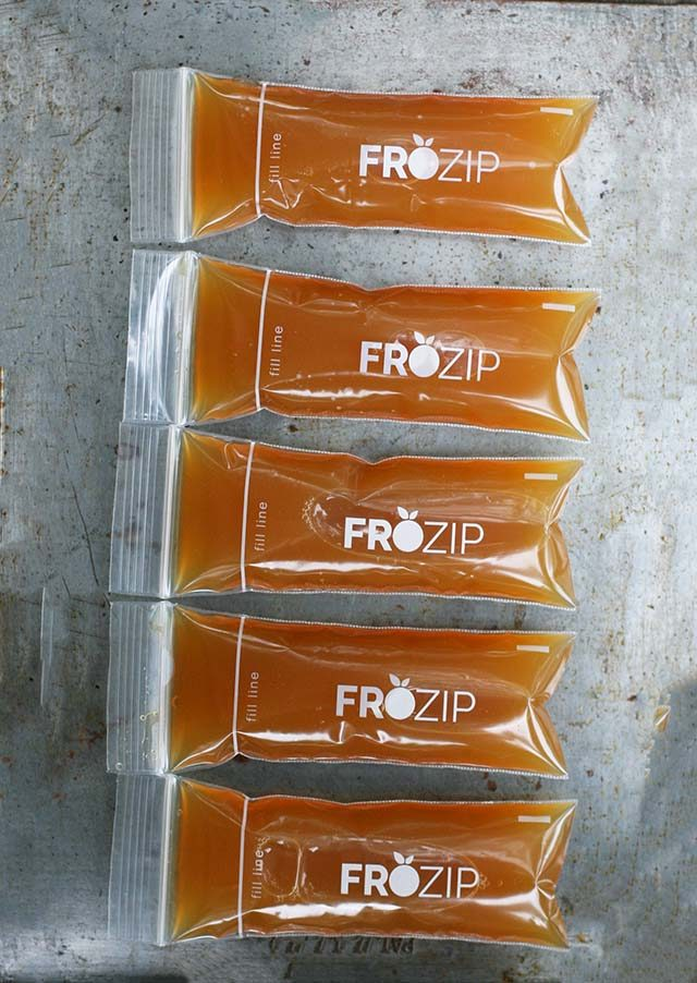 Homemade apple cider pops, made with disposable ice pop molds. Click through for instructions!