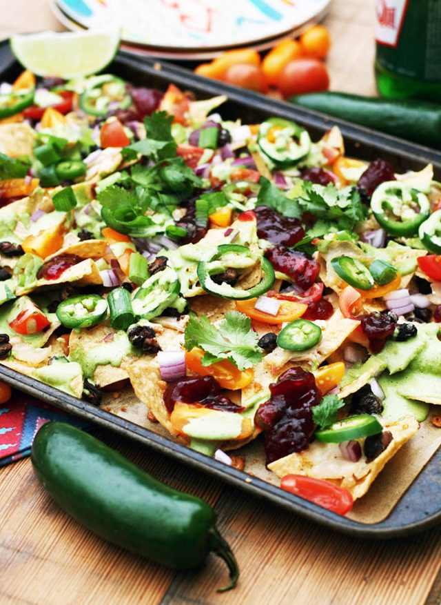 Thanksgiving nachos: A BRILLIANT recipe using up leftover Thanksgiving turkey and cranberry sauce (made into cranberry salsa!) Click through for recipe.