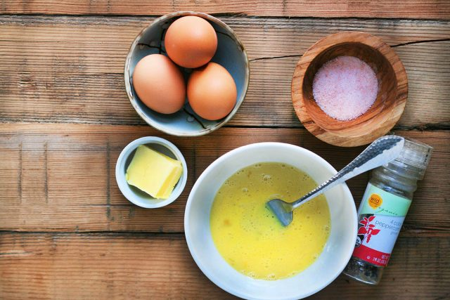 Ingredients for simple, delicious, perfect scrambled eggs: Eggs, butter, salt, and pepper. Click through for detailed instructions to make perfect scrambled eggs!