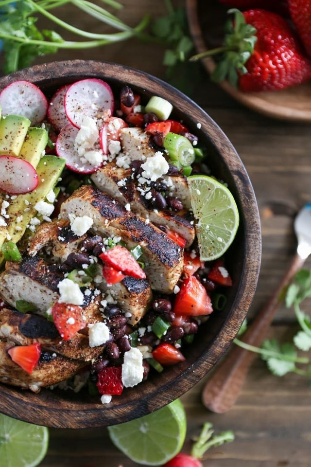 Balsamic grilled chicken salad with strawberry-black bean salsa: A delicious, hearty salad with a burst of freshness from the strawberries.