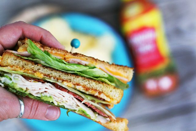 Grilled club sandwiches, with a sweet-tangy sauce. Learn how to make these classic sandwiches at home!