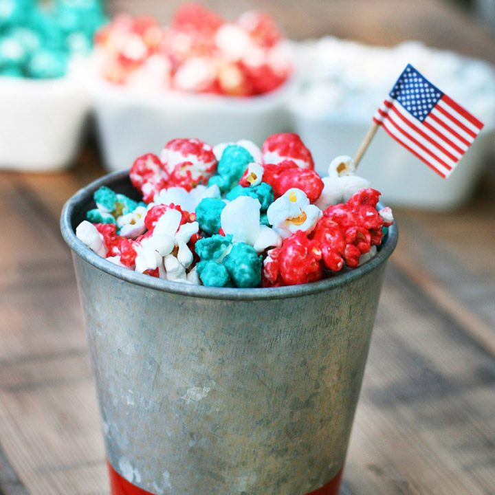 Red, white, and blue popcorn. Learn how to make this patriotic candied popcorn at home!